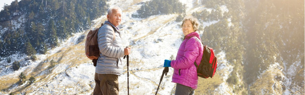 happy-senior-couple-hiking-on-the-mountain-picture-id935347410.jpg