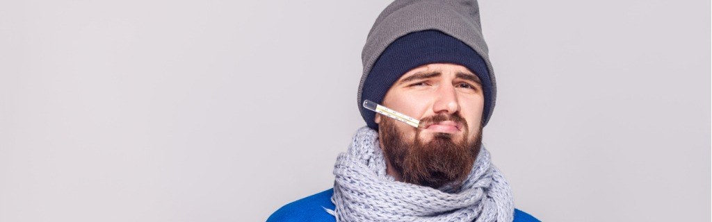 young-adult-bearded-man-have-temperature-holding-thermometer-in-mouth-picture-id885311386.jpg