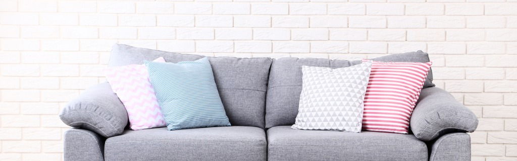 colorful-soft-pillows-on-gray-sofa-picture-id1127523292.jpg