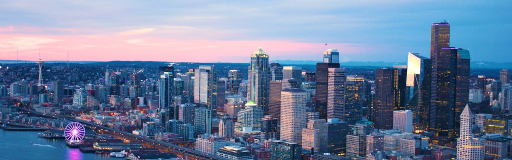 seattle-washington-usa-downtown-waterfront-aerial-panoramic-shot-pink-picture-id940712378.jpg