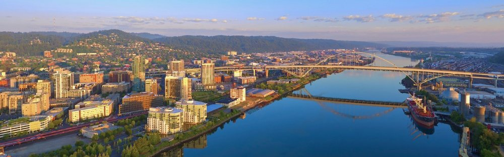 aerial-sunrise-of-the-fremont-bridge-and-the-waterfront-in-downtown-picture-id1032633728.jpg