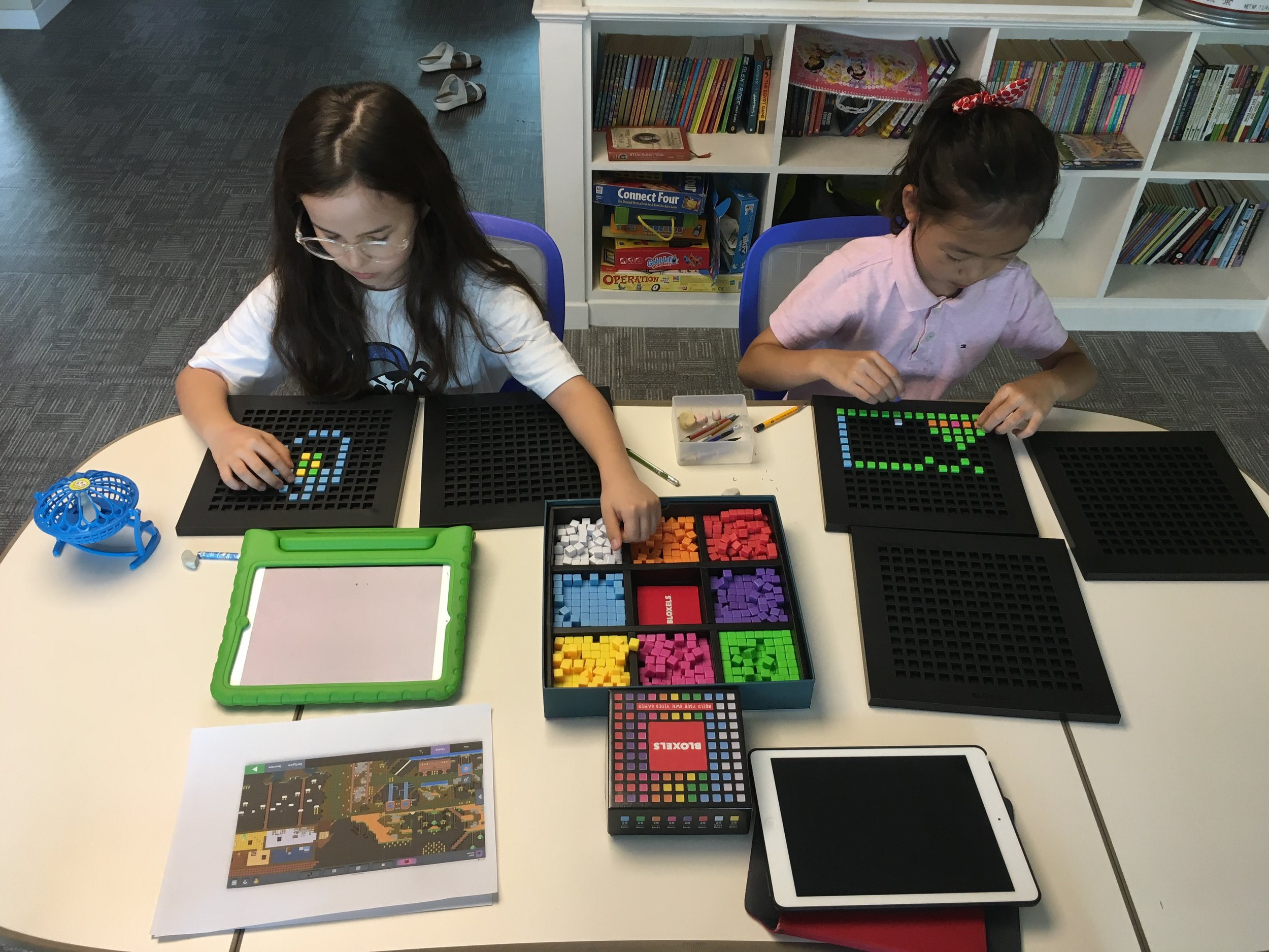 Asia and Katy use the Bloxels boards to build their games.