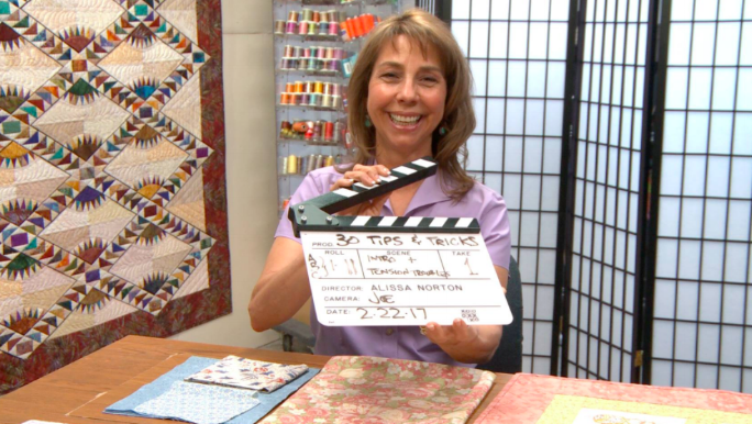 Cindy Seitz-Krug, instructor of 30 Tips & Tricks for Better Machine Quilting, hamming it up on set!