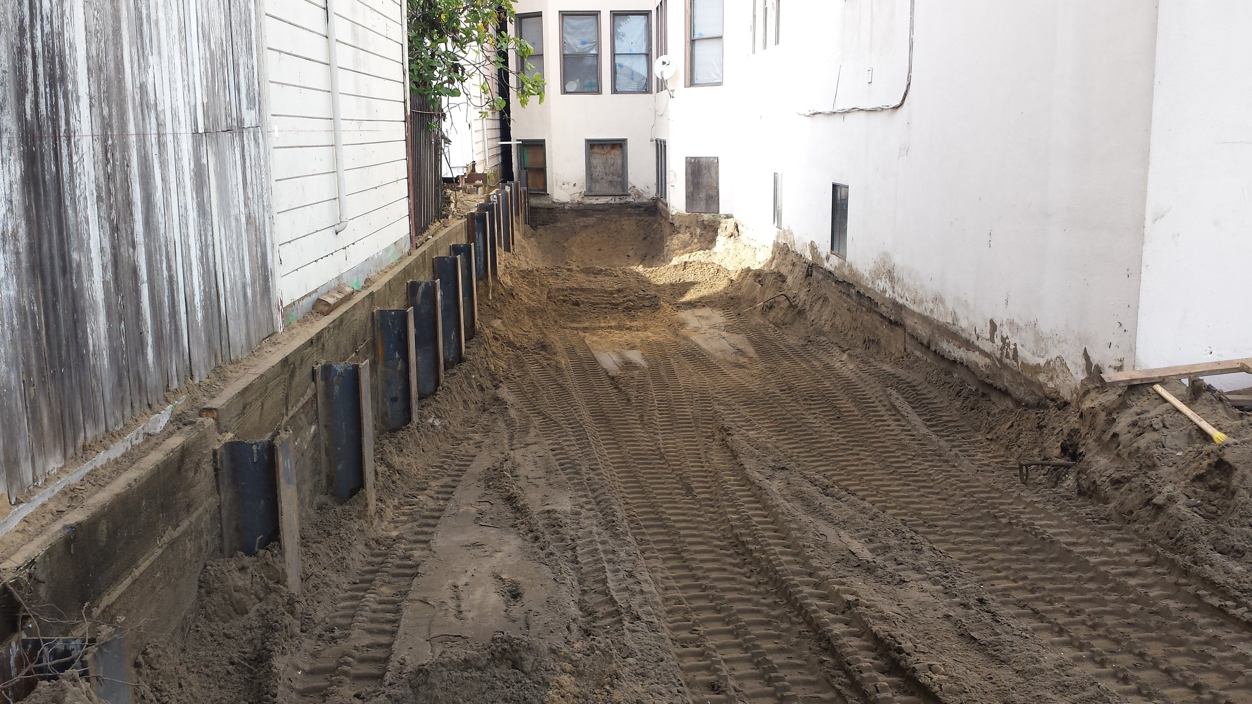 Rectory exterior excavation and retaining wall.