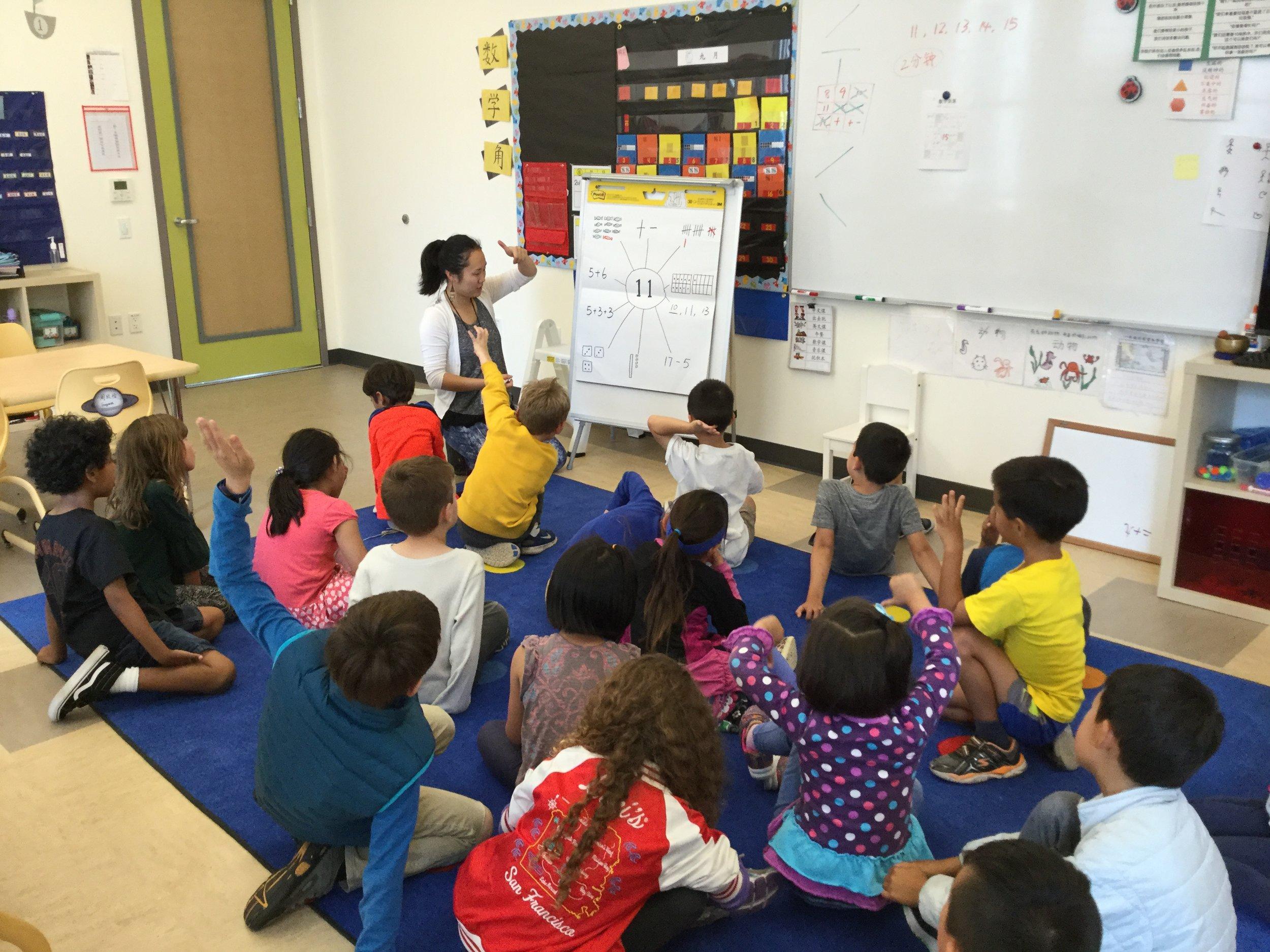 Busy first graders enjoying class activity .