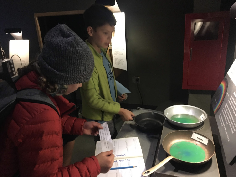 At the Exploratorium. Students are examining different ways a museum can present information so that it is engaging and interactive.