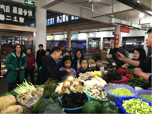Students at the local market, shopping for the ingredients for the dish they would later cook for lunch.