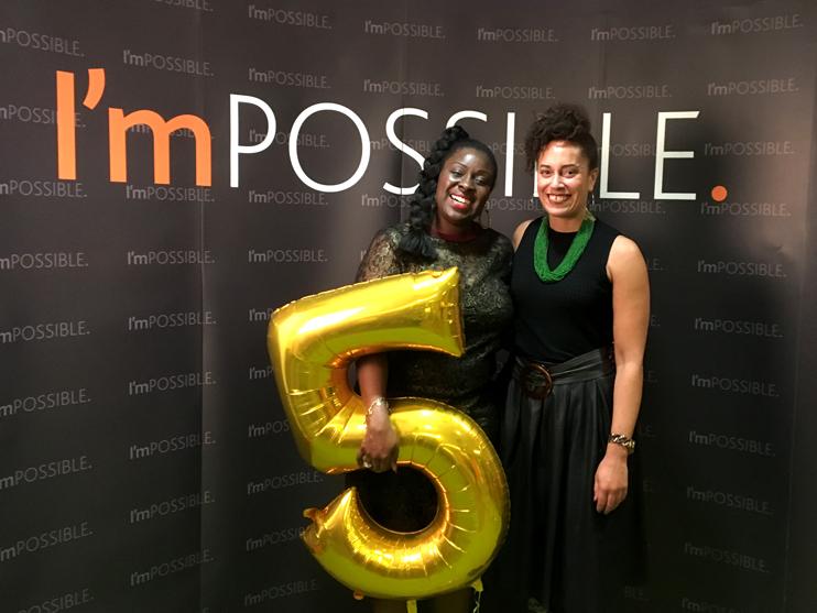 Simone Bresi-Ando and Carolyne Hill - against the original logo I designed over 5 years ago!