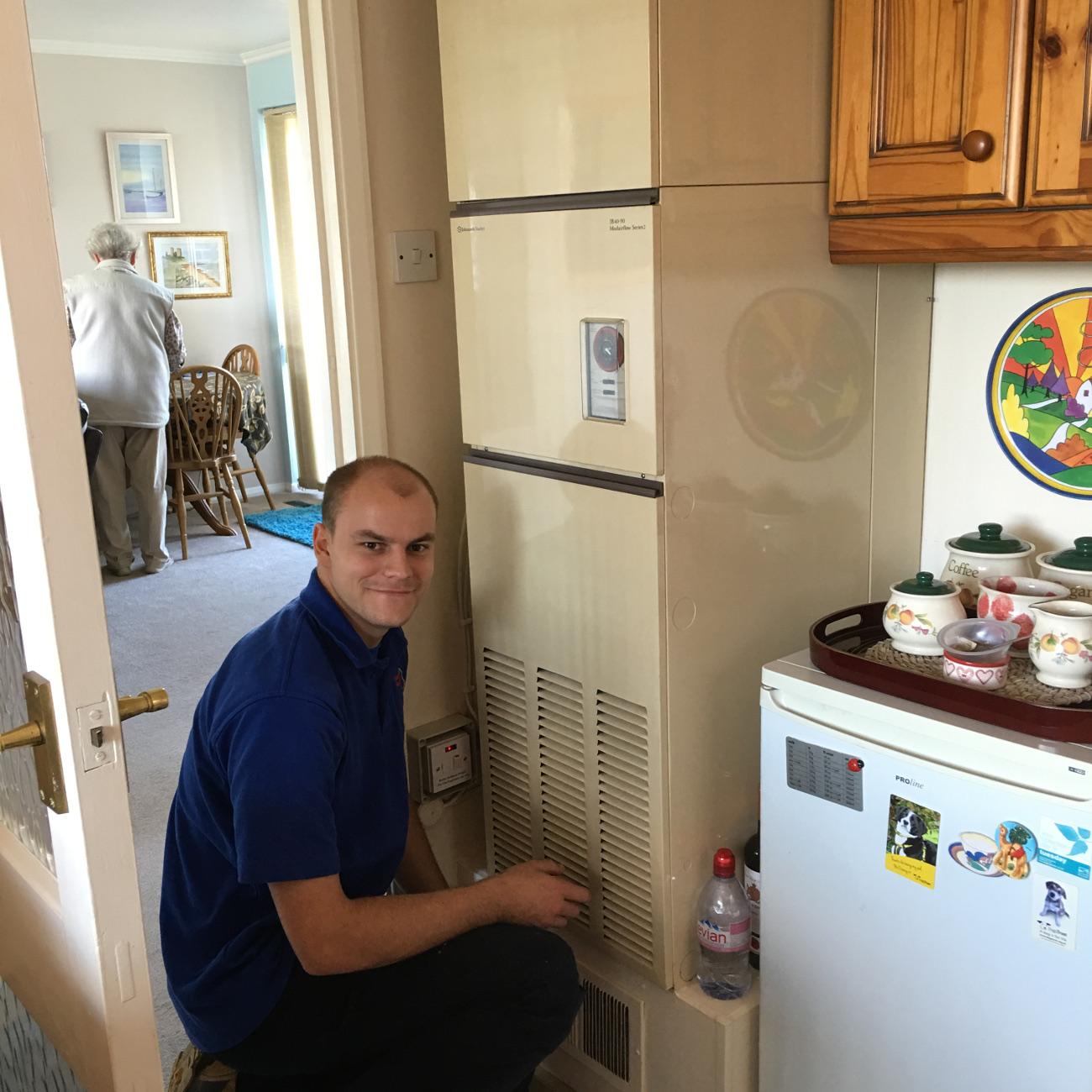 Our Engineer Adam Servicing a Warm Air Unit