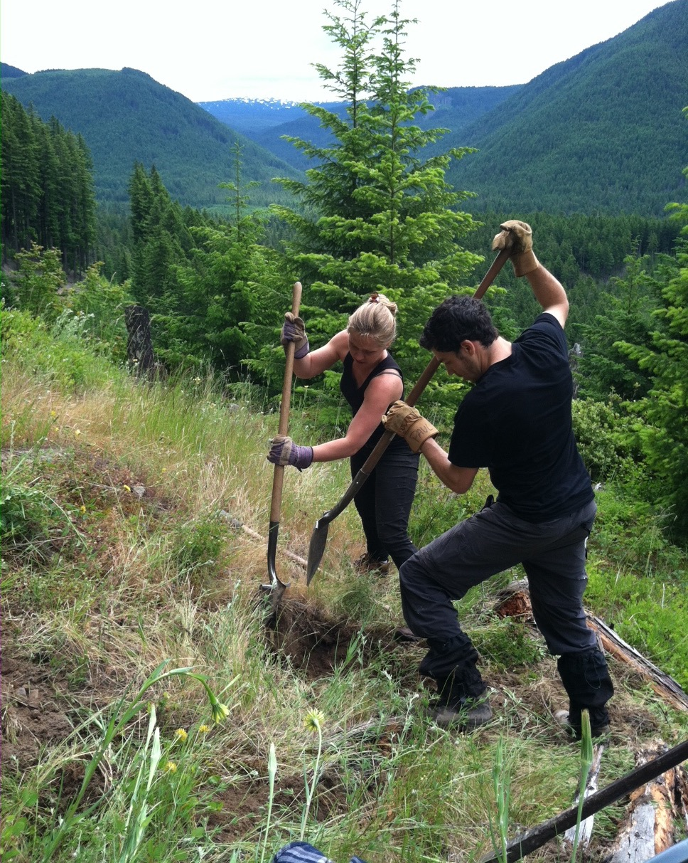 Installing a sensor near Mt. St. Helens, WA in 2014. Gina is helping me dig the ~1m deep hole in which we will bury the sensor.