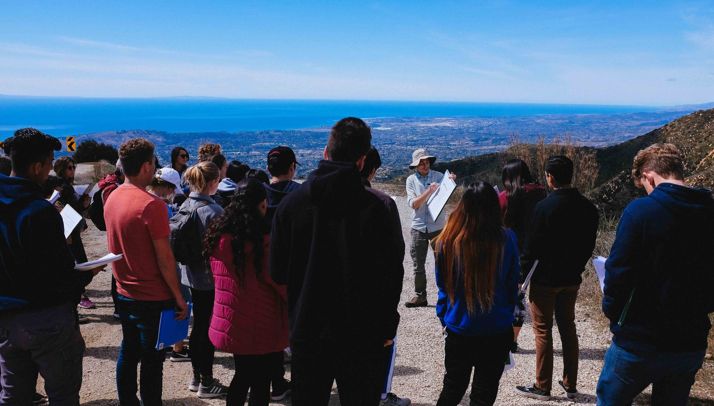 Leading a UCSB undergraduate field trip in the Santa Ynez mountains. Immediately behind me, you can just about make out the UCSB campus nestled against the coast.