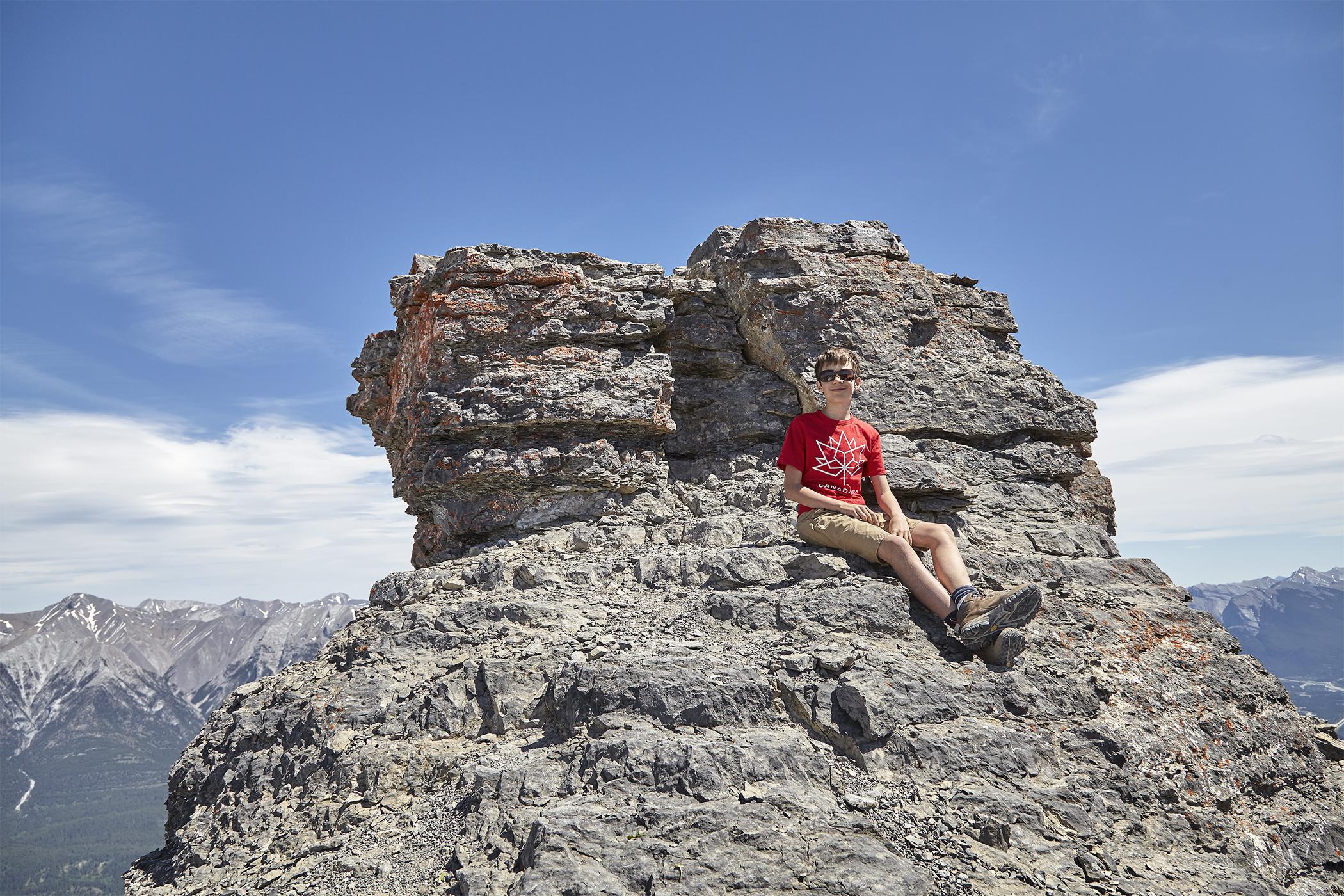 Yuri sitting on the summit block.