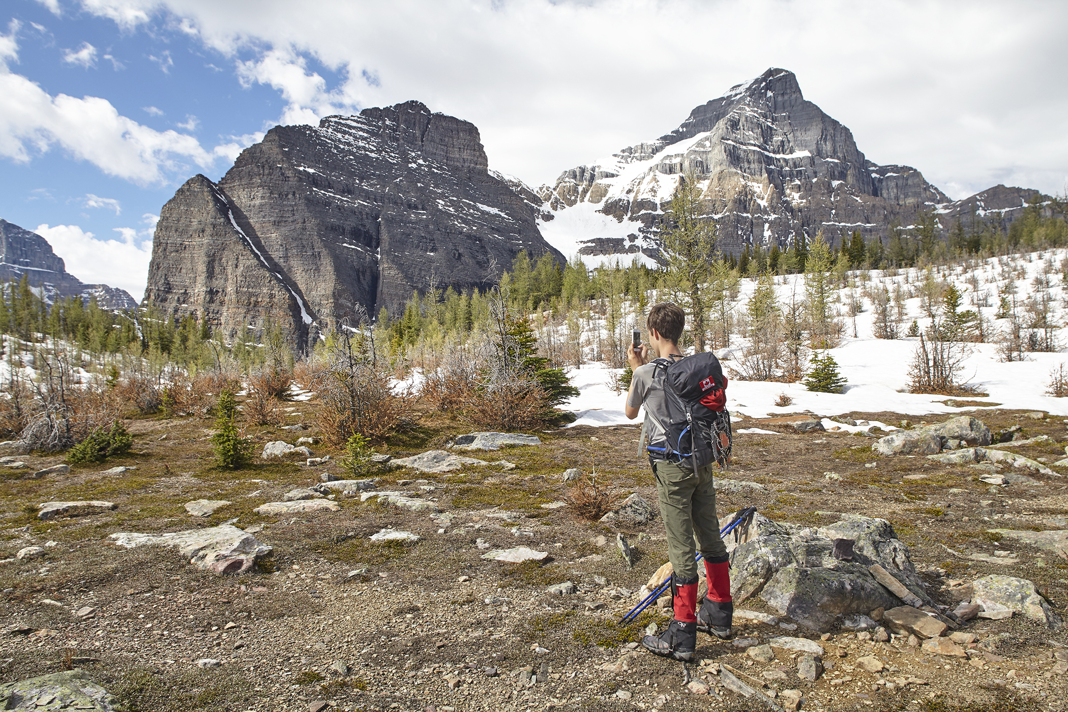 Yuri at Saddleback Pass with Sheol Mountain and Haddo Peak looming behind.