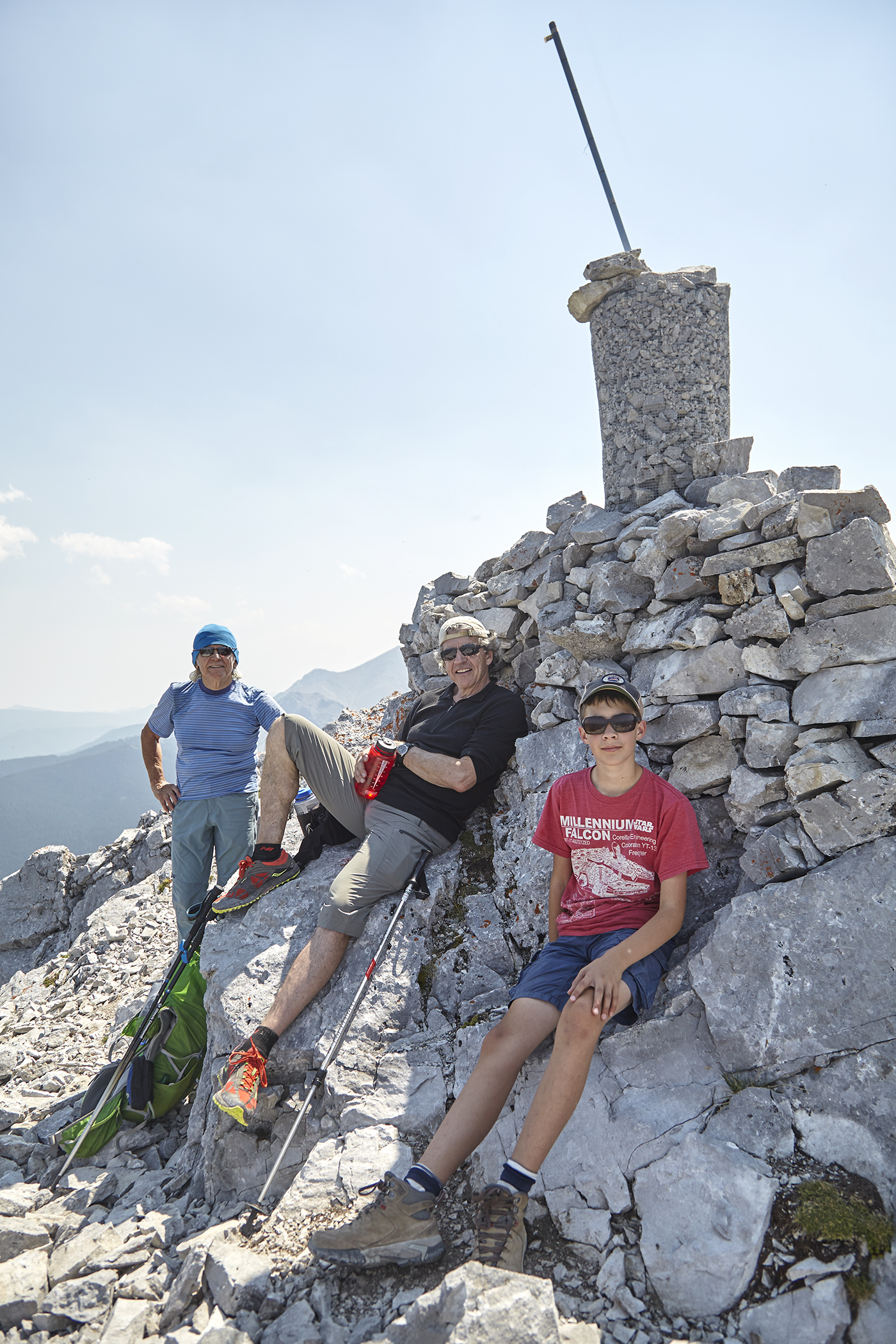 Milan, Wayne and Yuri sit under the strange summit cairn.