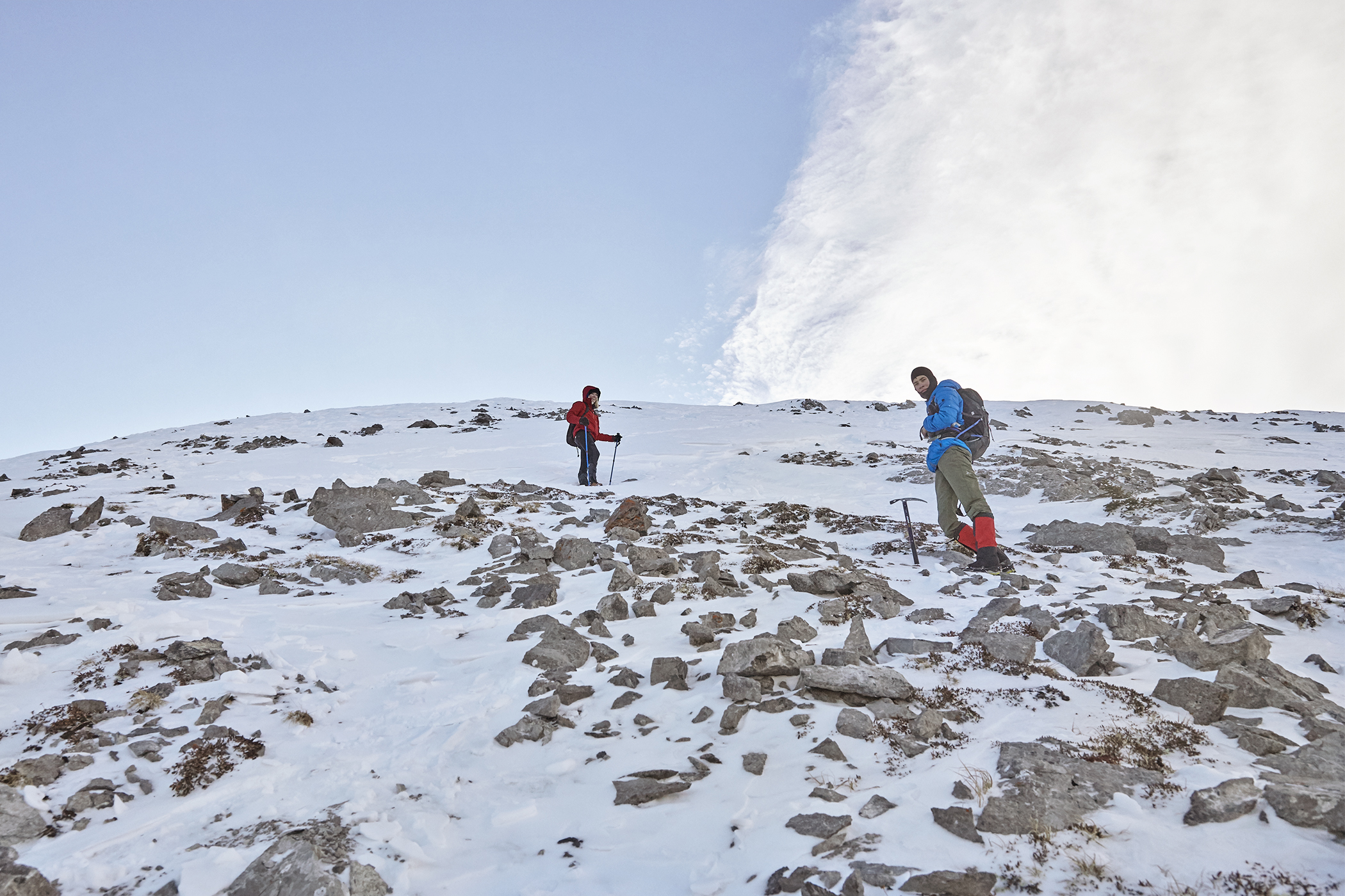 Yuri and Mindy ascend the last portion of snow and talus to the summit.