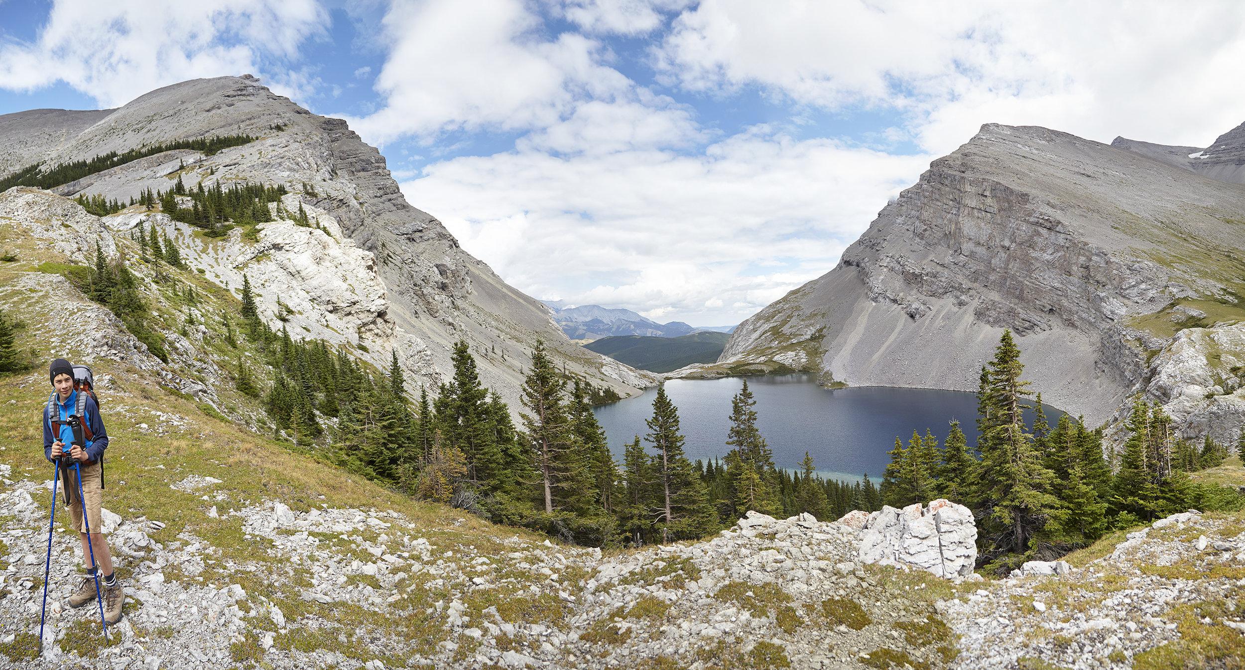 A panorama of Mount Strachan, Carnarvon Lake, and Mount MacLaren.