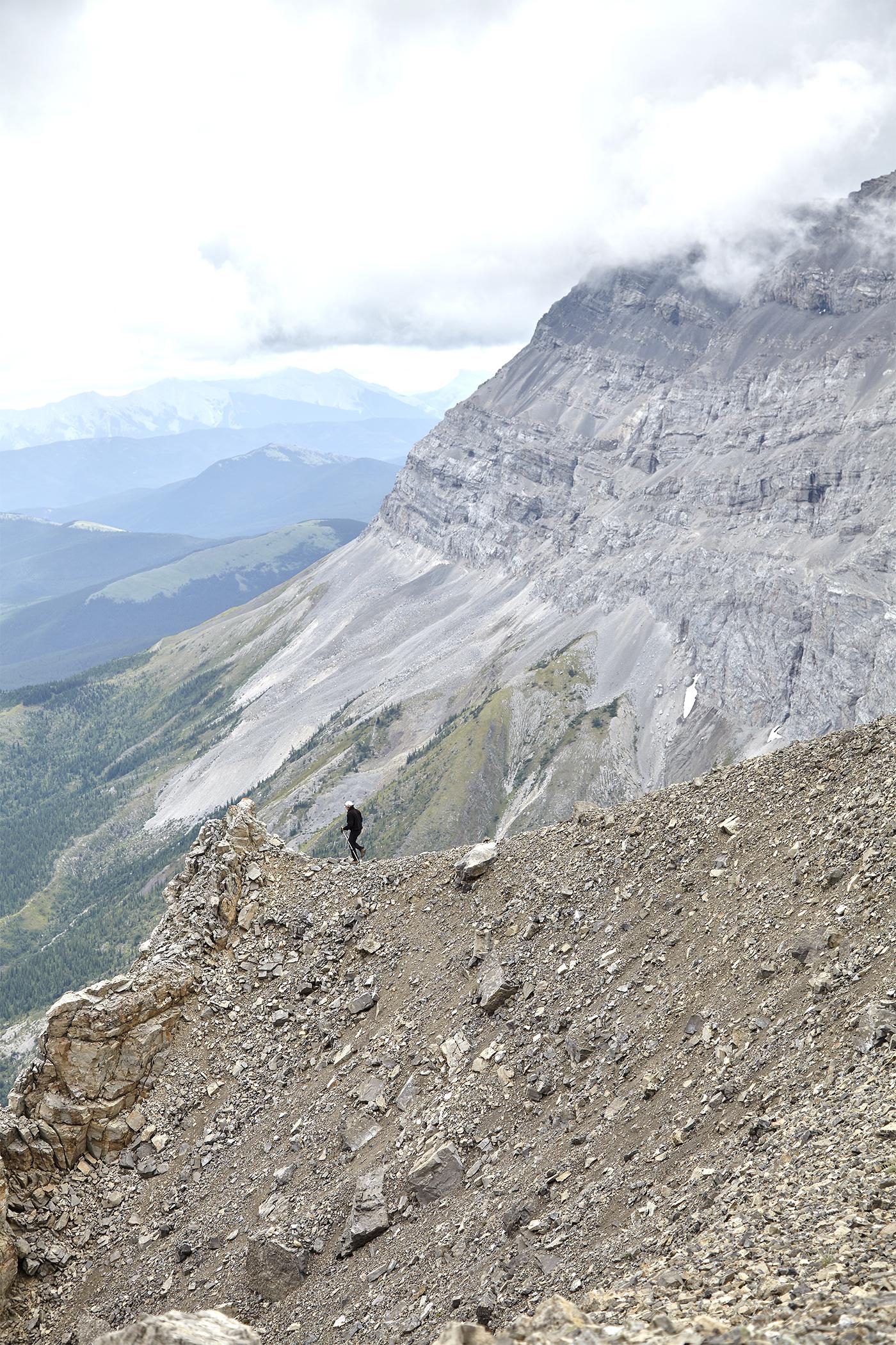 Wayne hikes down to check out a pinnacle.