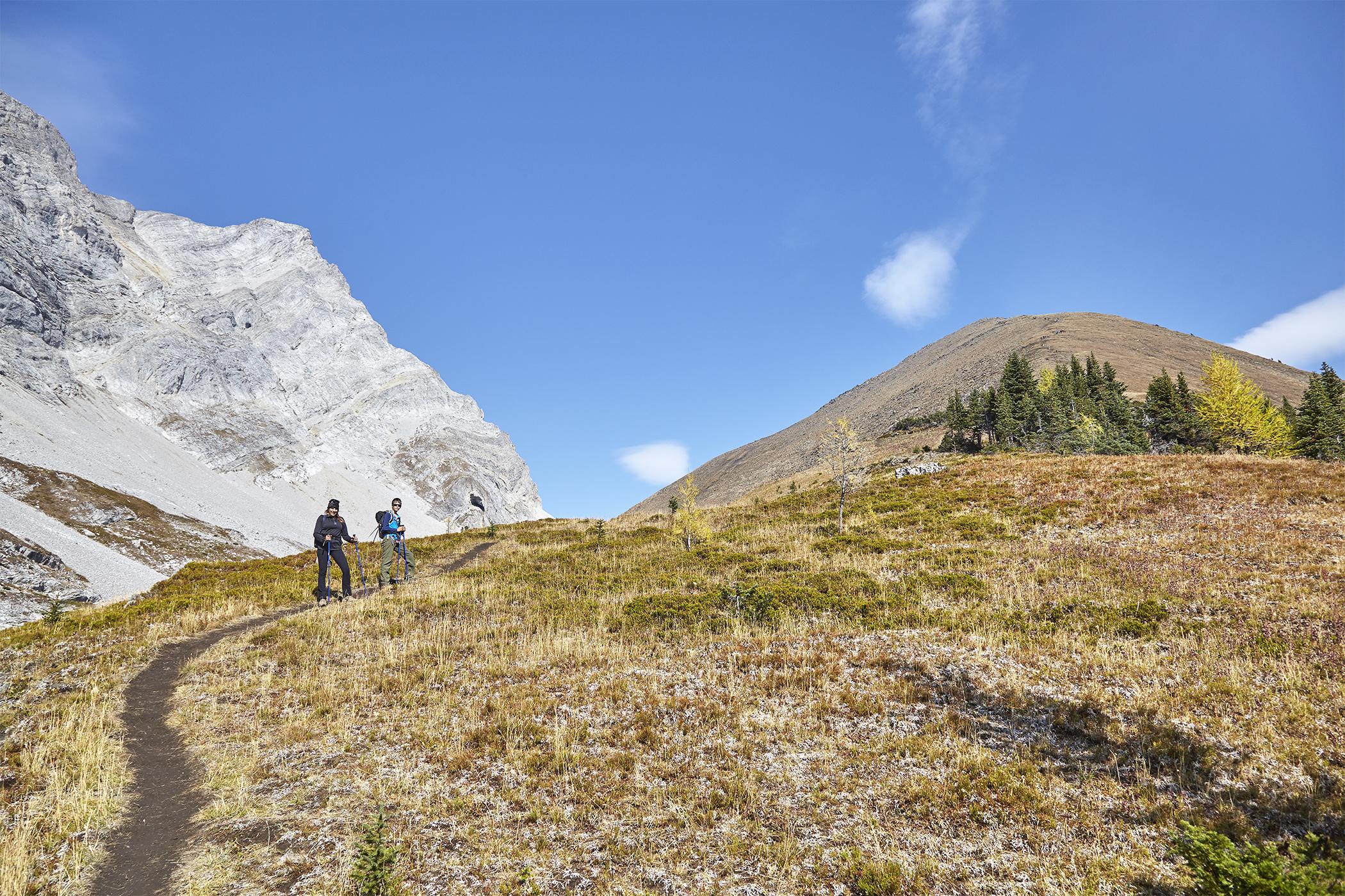 Nadien and Yuri start up the below slopes of Pocaterra Ridge.