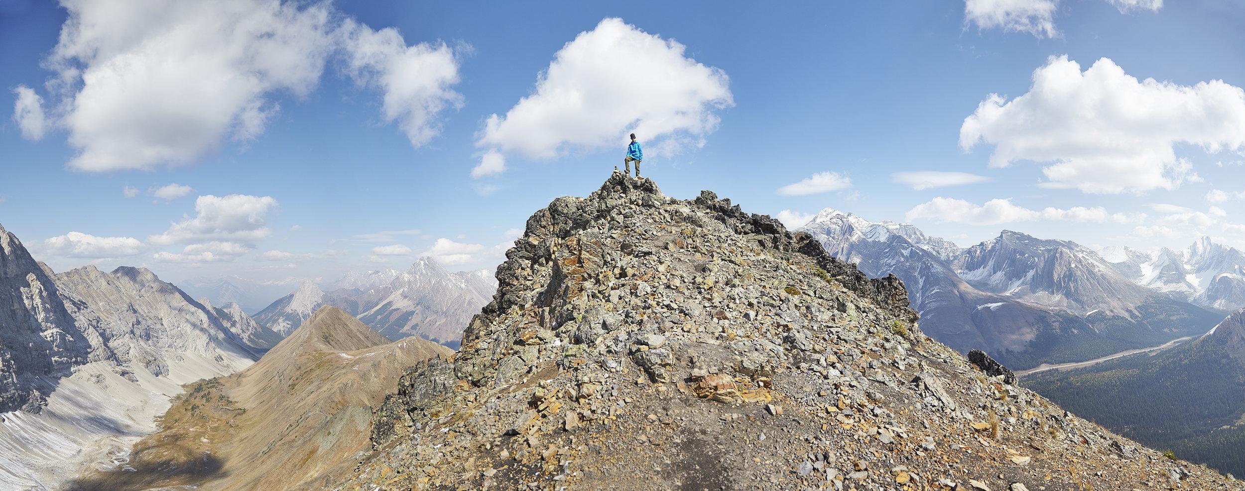 Yuri on the summit of Pocaterra Ridge.