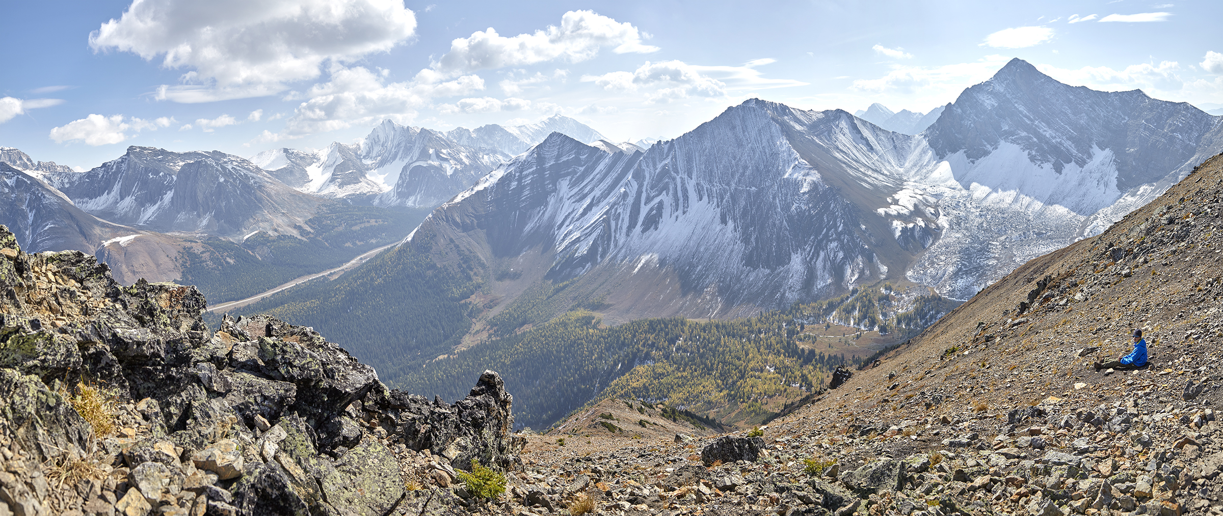 A summit panorama. Yuri is relaxing just below the summit.