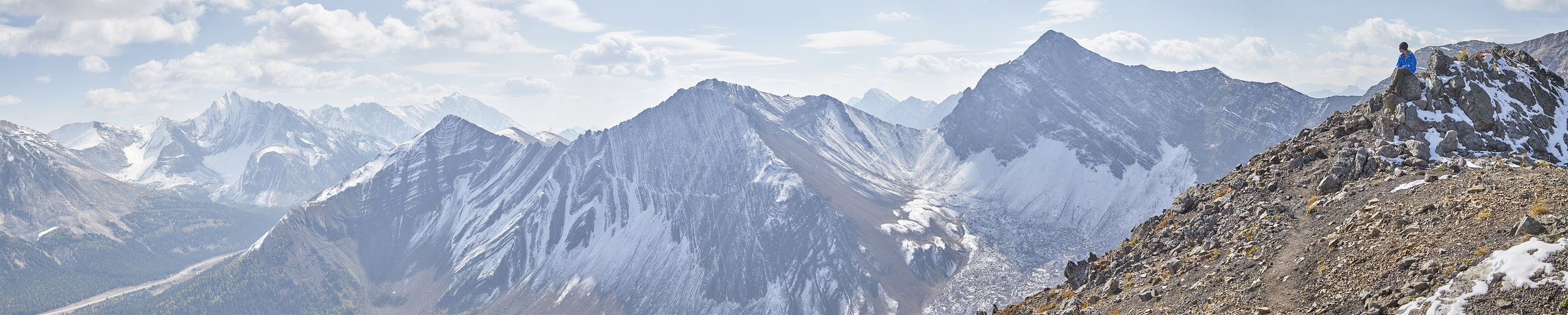 Yuri admires Highwood Ridge, Grizzly Ridge, and  Mount Tyrwhitt  from the summit of Pocaterra Ridge.