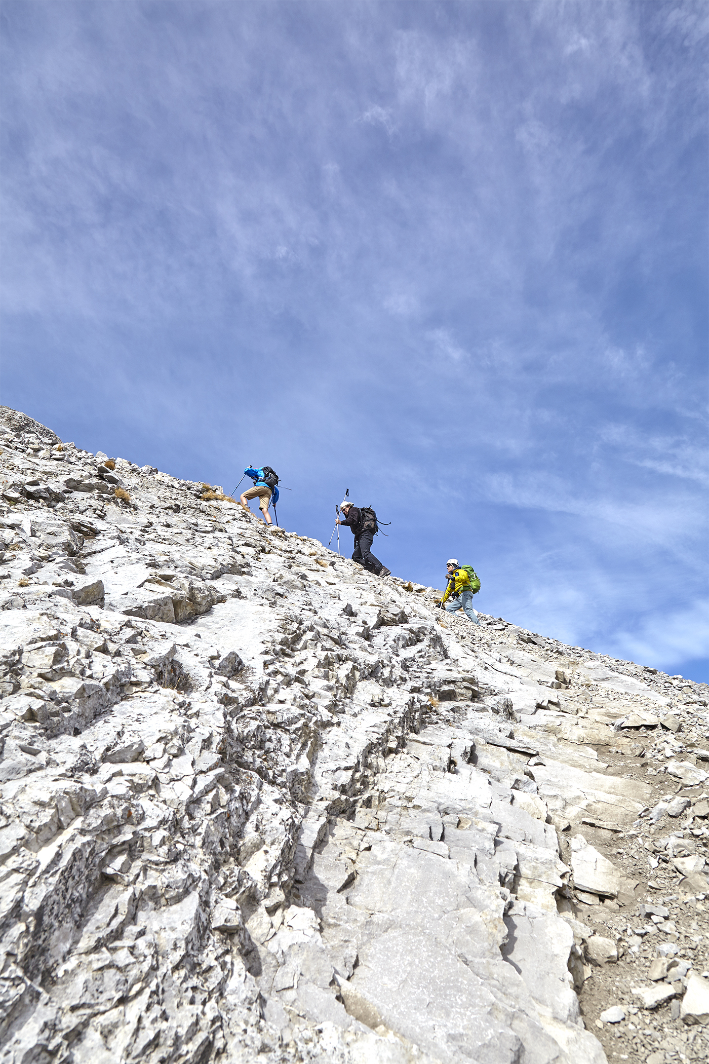 Yuri, Wayne, and Milan scale a steep slab near the summit.