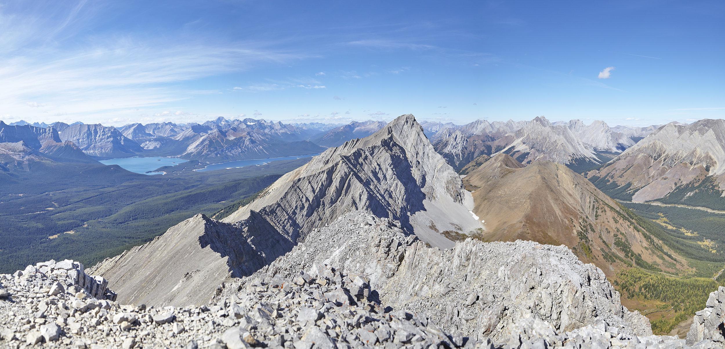 A summit panorama looking north towards Mount Pocaterra and the Kananaskis Lakes.