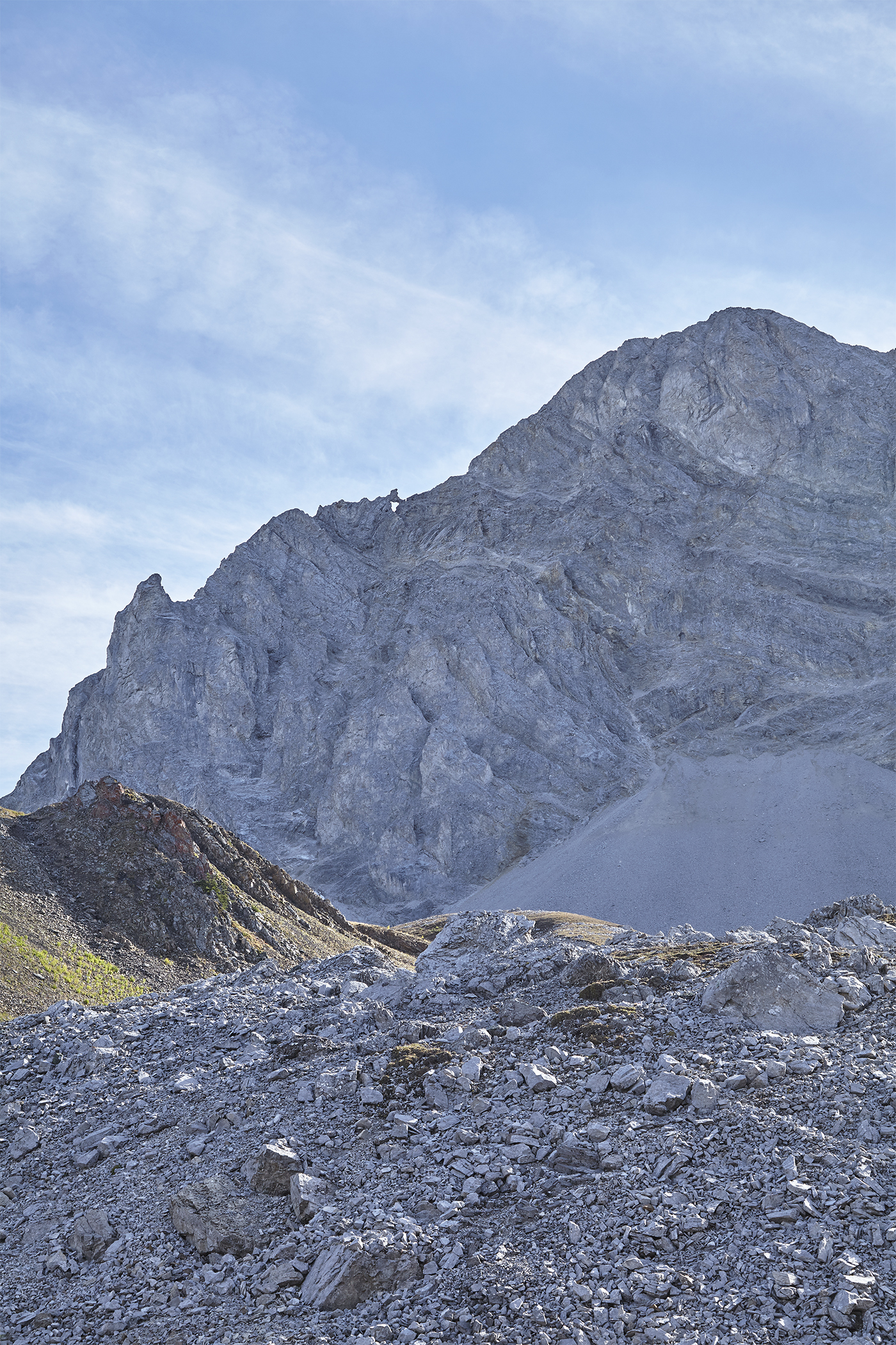 Looking at Mount Tyrwhitt's sheer north-east face from Pocaterra Cirque. Note the rock arch halfway up the ridge.