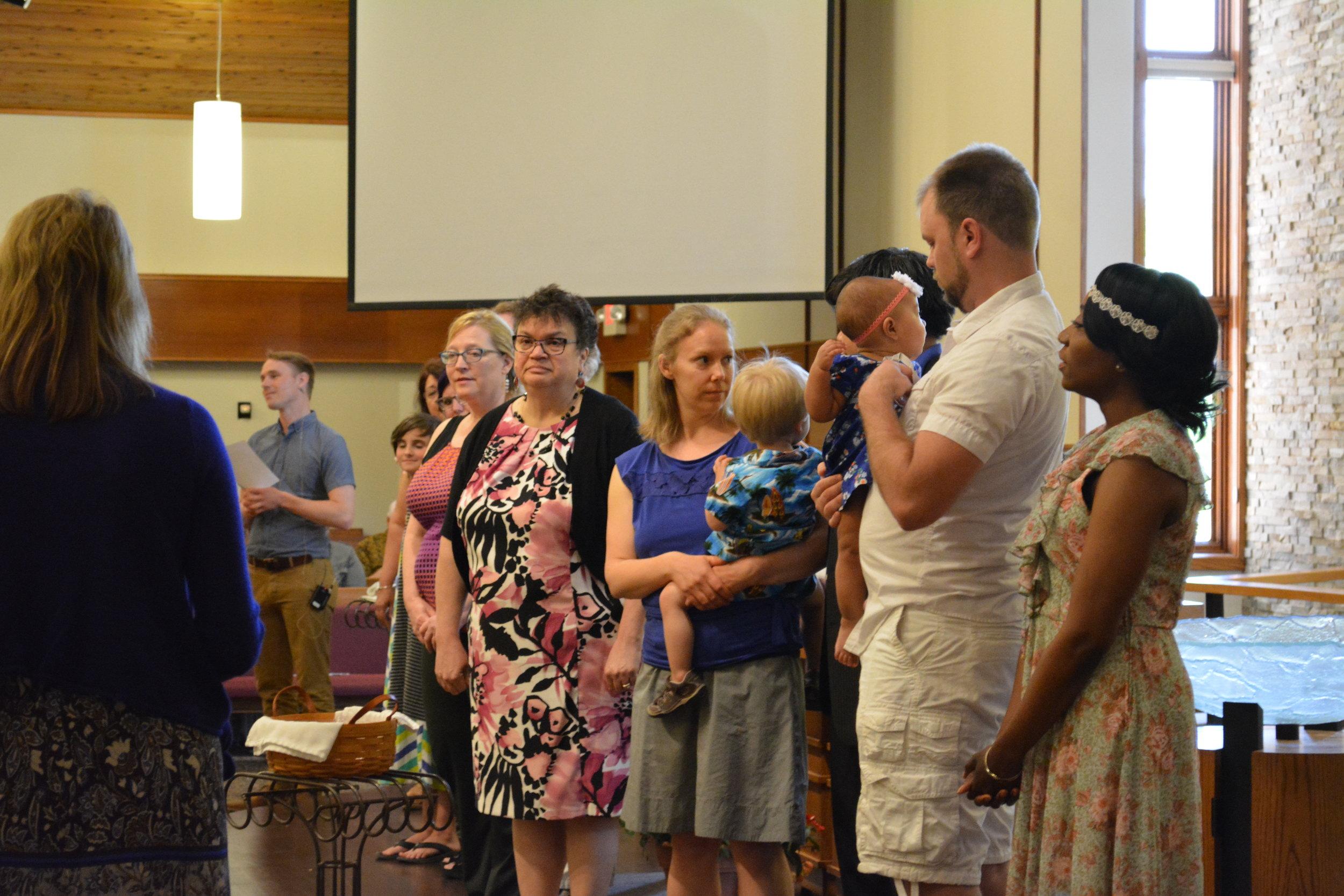 Celebrating three baptisms on Baptismal Sunday.