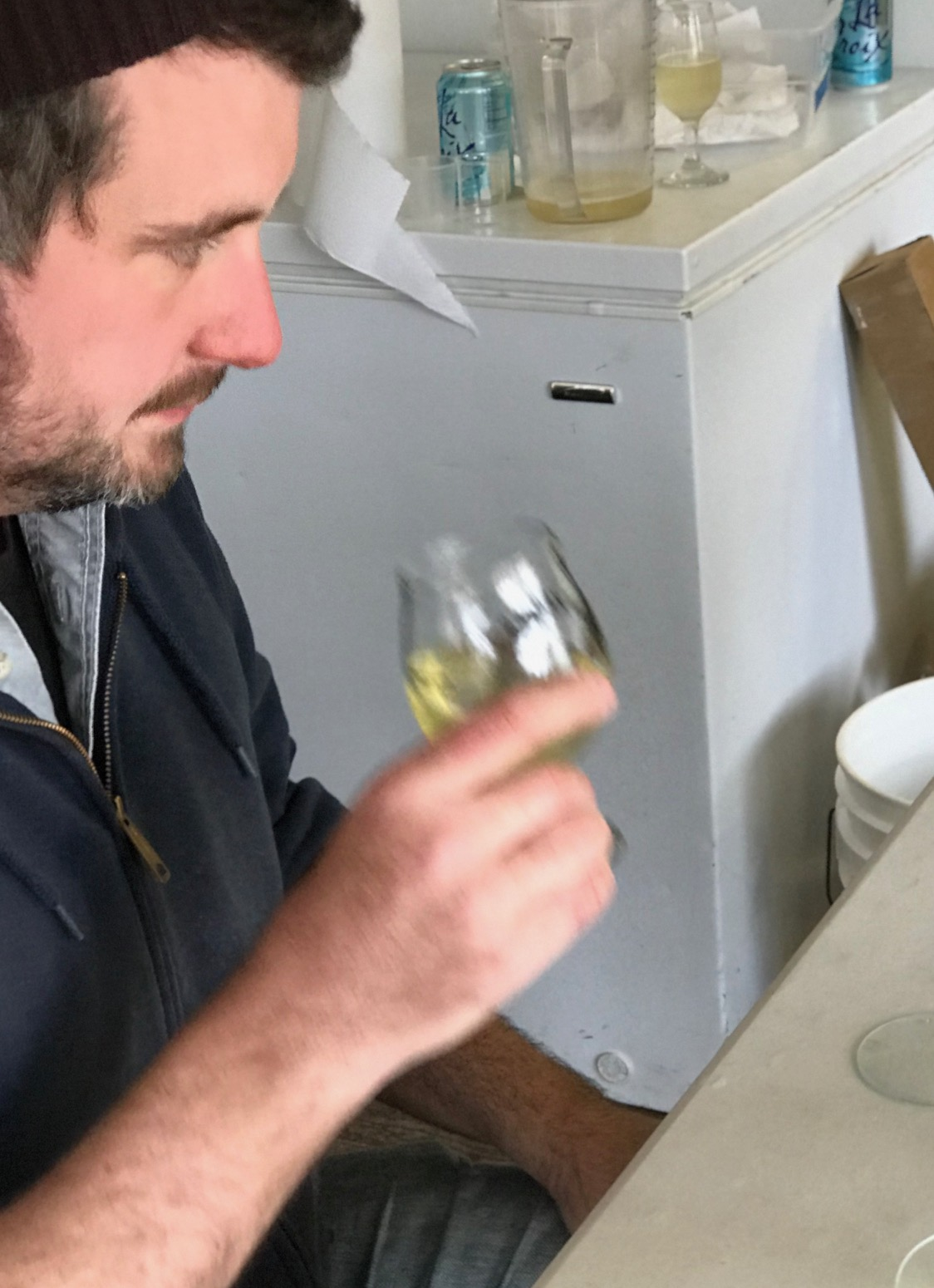 Nick checking on our new bittersweet cider.