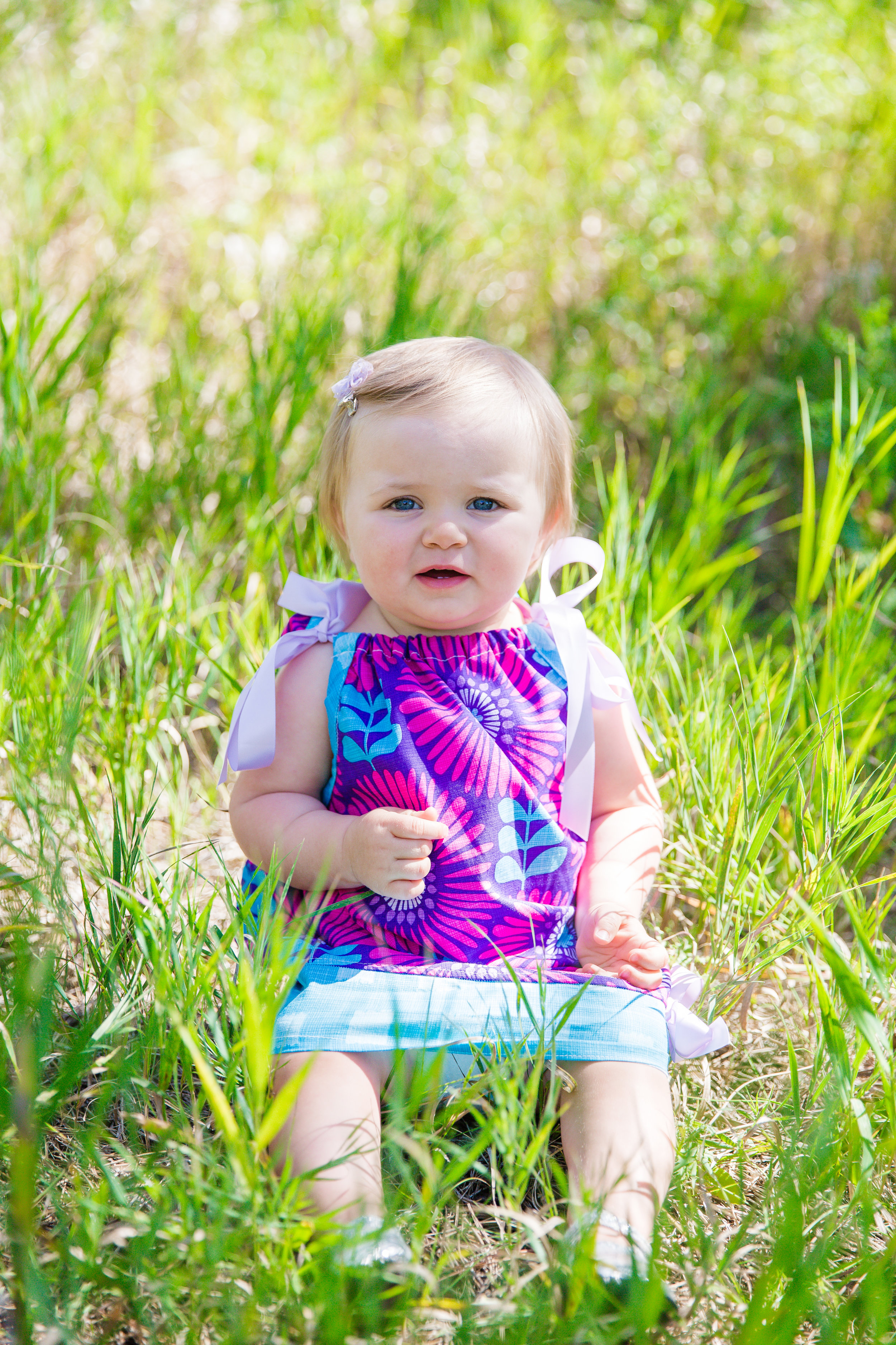 Kinley is ONE! This was my second time photographing this little girl. The first time was during her newborn session which I remember vividly because she was a little sleeping beauty! Her one year session was full of laughter and smiles. She enjoyed her delicious smash cake from  JJ's Cakery  as did mom and I :) Kinley is so full of personality, I can't wait to photograph that adorable smiley girl again!