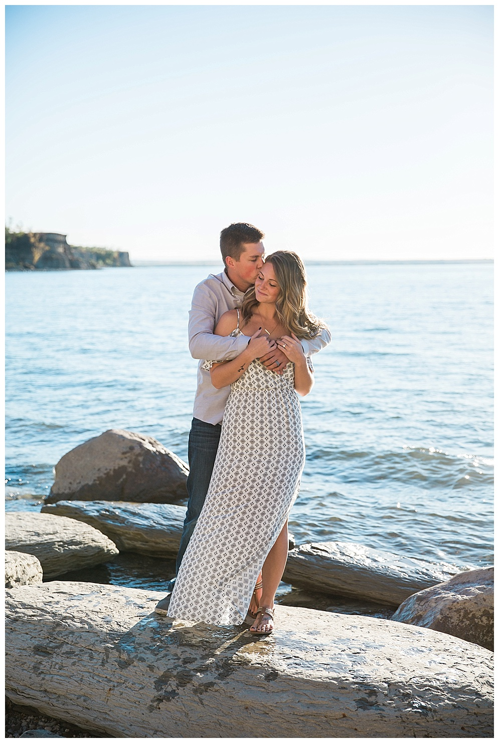 """On August 15th, 2015 I had the privilege of photographing Ashley & Logan as they said """"I Do."""" A year later, I joined them on the beaches of Lake Sakakawea to celebrate their anniversary! These two hold a special place in my heart. Logan is a longtime friend and softball teammate to my husband Tyson and over the years I have been lucky enough to build a friendship with both of them. They are one of our go-to couples for fun nights out and good laughs! I enjoy watching their relationship grow and can't wait to see where they are in another year!"""