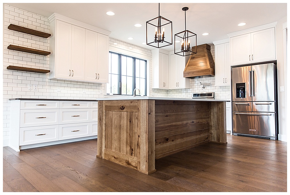 This rustic white kitchen stole my heart.  For more custom homes by Prestige Home & Design click  HERE!