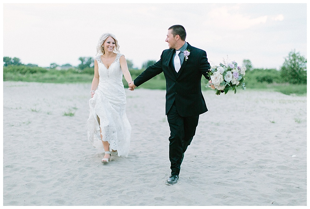 """""""We started planning the day after we got home from Mexico. I had a good idea of where I wanted it and the time frame but we just had to coordinate the dates with all of the vendors we wanted! Luckily everything worked out with everyone we wanted so we got all the bigger things booked right away! We went with neutral grey colors with hints of lavender and it turned out exactly what we had picture.""""  Cinematography: videography by l.j. Cake: cake dreams, Mandan Invitations: uniquely you photography and design Ceremony Venue: st. Joseph's church, Mandan Reception Venue: ramkota hotel Floral: Crabapple Floral Decorator: 701 design + events Rings: Schumacher diamond Brides Dress: white lace bridal Headpiece or Veil: white lace bridal Bridesmaids' Dresses: white lace bridal Hair and Makeup: image makers salon Grooms & Groomsmen Attire: white lace bridal   """"Melanie, we cannot thank you enough for the photos you captured during our engagement session and wedding day! They are more beautiful than we could have ever imagined! We will cherish them forever♥"""" -Shawnee"""