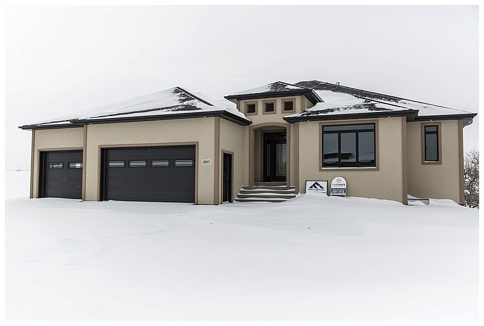 This beautiful home is for sale! Located in North Bismarck overlooking the Missouri River. Check out  Eddy Mitzel Homes  on facebook to see more.