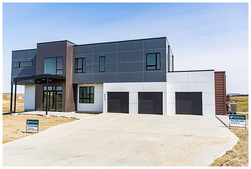 Located at 8233 Trevino Drive in North Bismarck, this home will leave you with your mouth open. Josh, owner of Prestige Homes, always impresses me with his over the top details and this home was no exception. The unique modern exterior is matched throughout the homes interior.  Some of my favorite features include the huge windows, incredible custom built staircase, custom made chandelier in the entry, 2 secret doorways, and the towel warmer in the master bath. If you didn't get a chance to view this home during the Parade of Homes you missed out, but I am sure Josh would love to build you a similar one :)  For more homes by Prestige Homes, click  HERE!