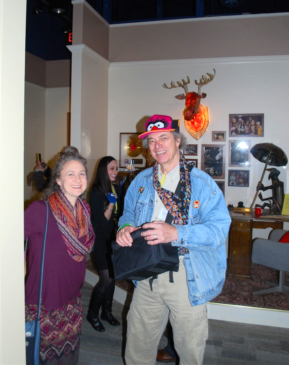 John with Heather Henson in front the re-creation of Jim Henson's office in the Henson Gallery at the Center for Puppetry Arts in Atlanta, GA.  John's moose head was bought by Jim Henson in 1965 in NYC.