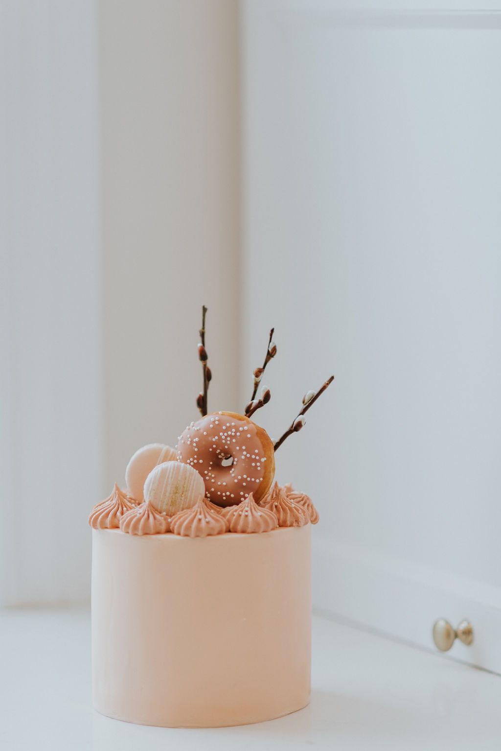 montreal bridal shower cake with donuts and macarons