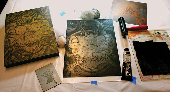 """Inking copper and zinc plates with OPEN Acrylics requires a little practice to perfect the wiping technique. On the left side of the image the final print is mounted to a wood panel using Soft Gel and then several thin coats of """"acrylic encaustic"""" were added."""