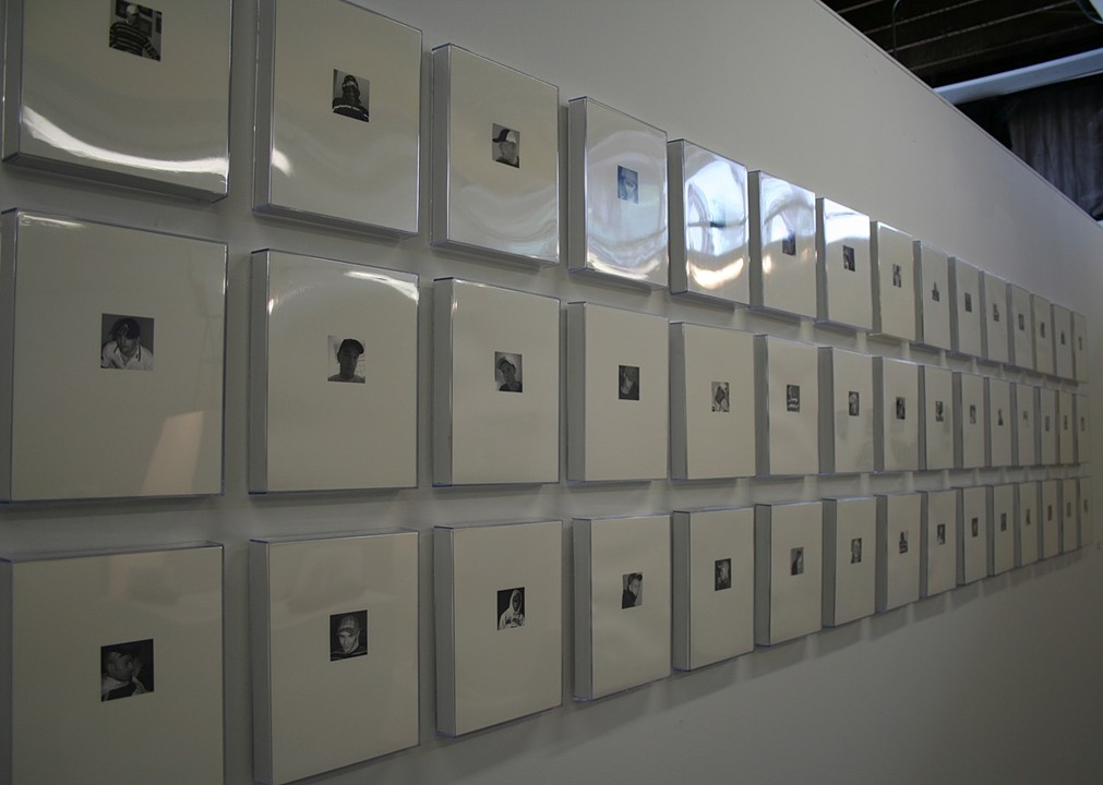 Cap Smoke'n Project, 2005 Photographic Installation: 45 black & white prints 4 x 4 inch printed on 9 x12 inch paper in acrylic frames.