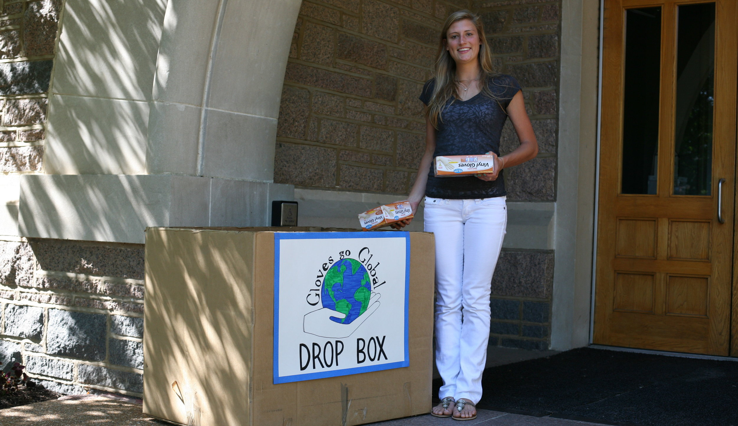Hannah collects gloves from a drop box outside of the biology building at Washington University in St. Louis