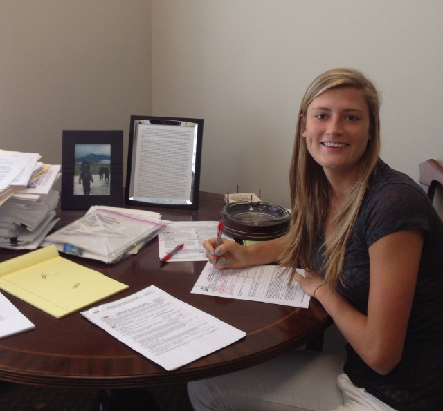 Hannah completes legal documents to certify Gloves Go Global as a non-profit organization