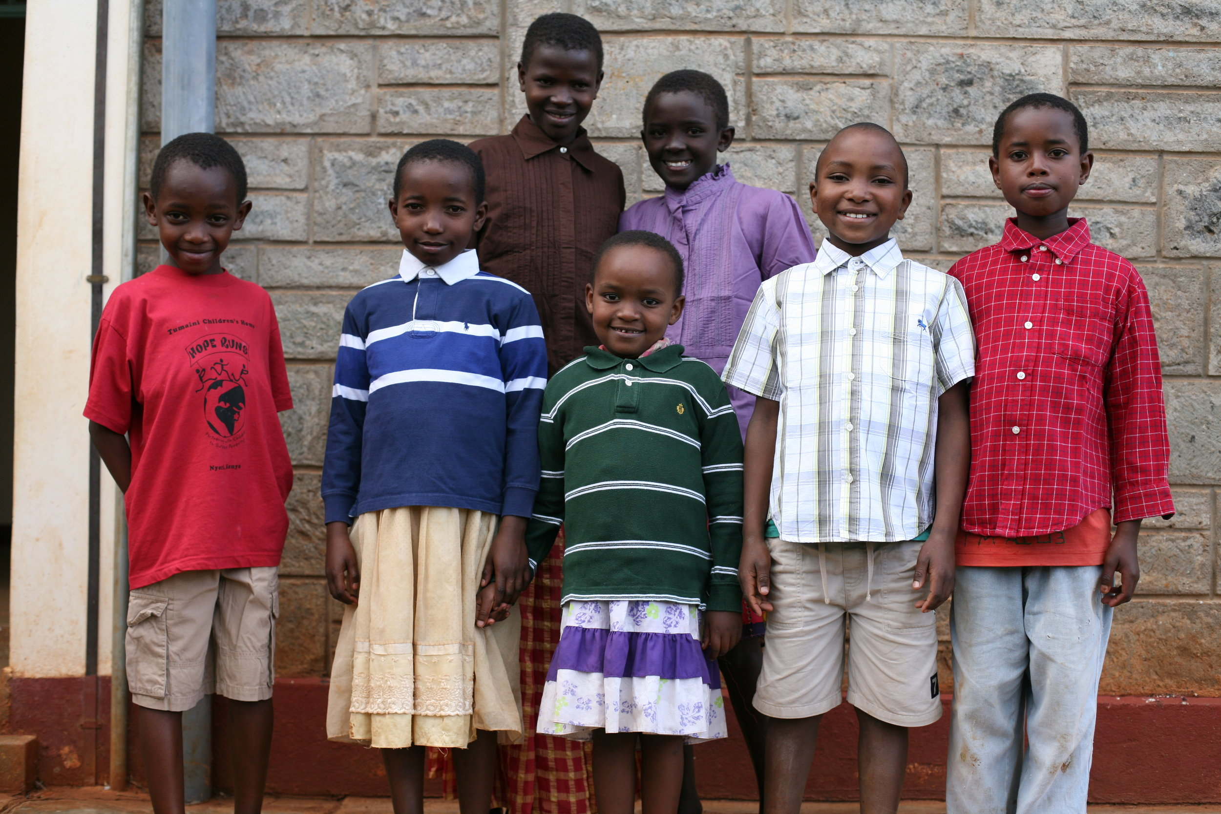 Children at Tumaini wait outside of the clinic for their checkup.