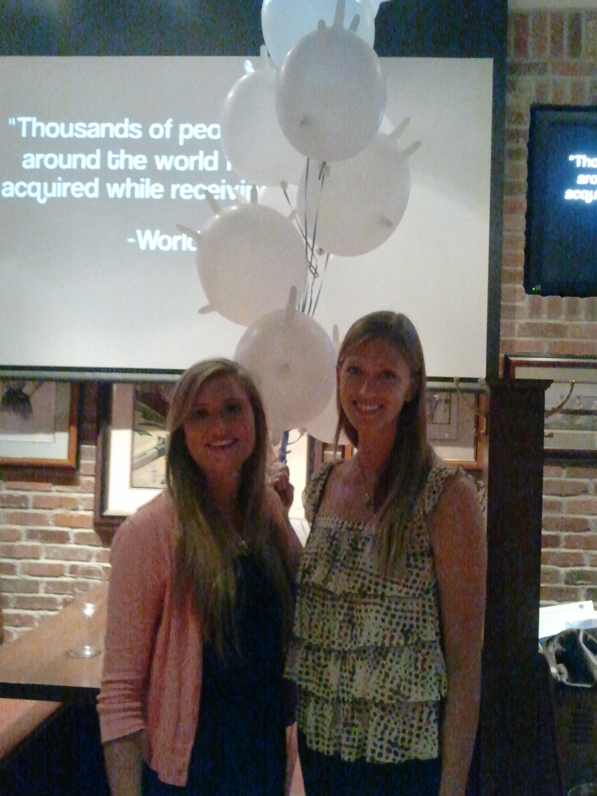 Geneva and Hannah stand in front of the premier of the 2013 documentary film.