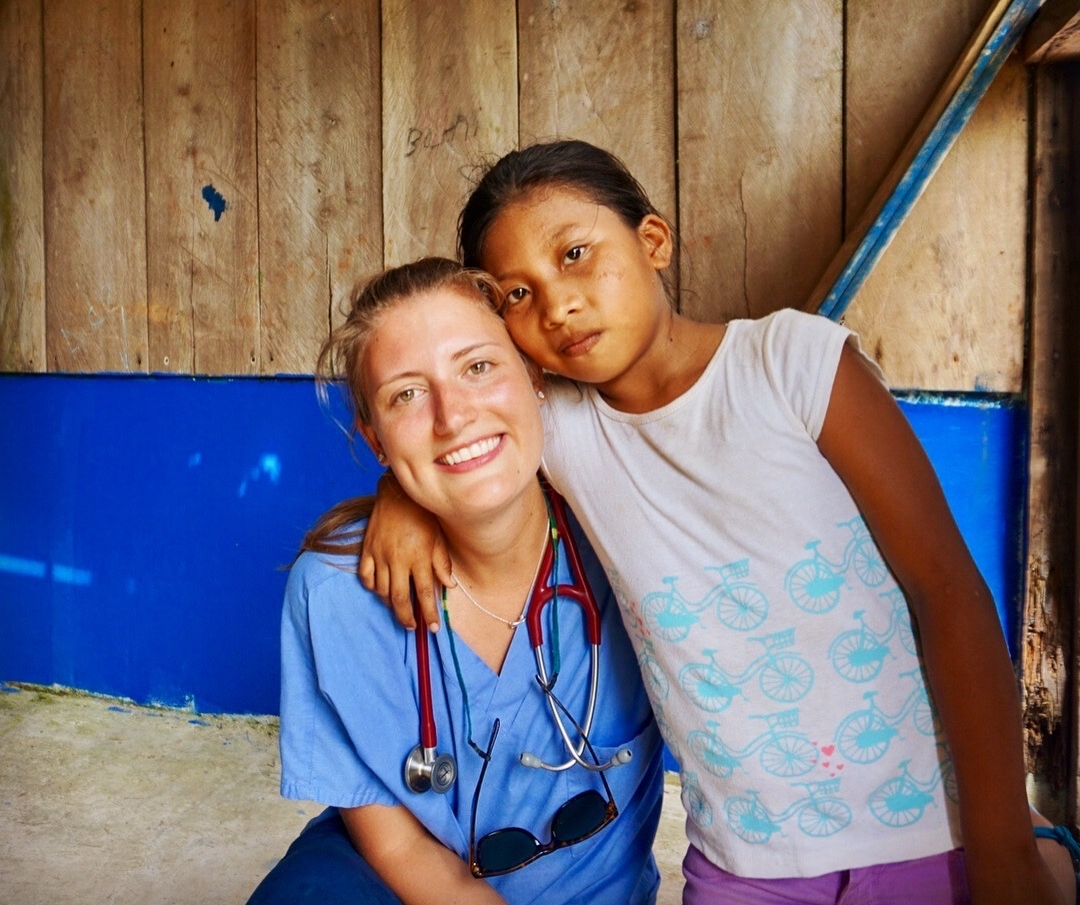 Hannah Akre with a young patient after clinic at Ensenada.