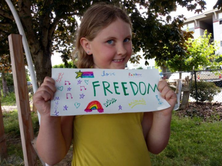 Flags created by CURJ youth will decorate the garden space