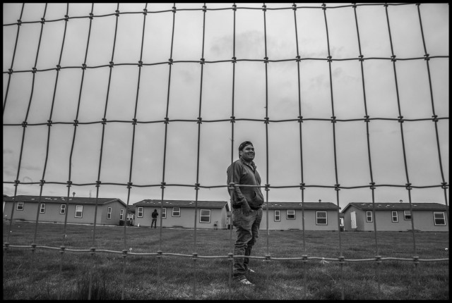 Dorian Lopez, an H2A guest worker from Mexico, lives in barracks in central Washington. Photo by David Bacon