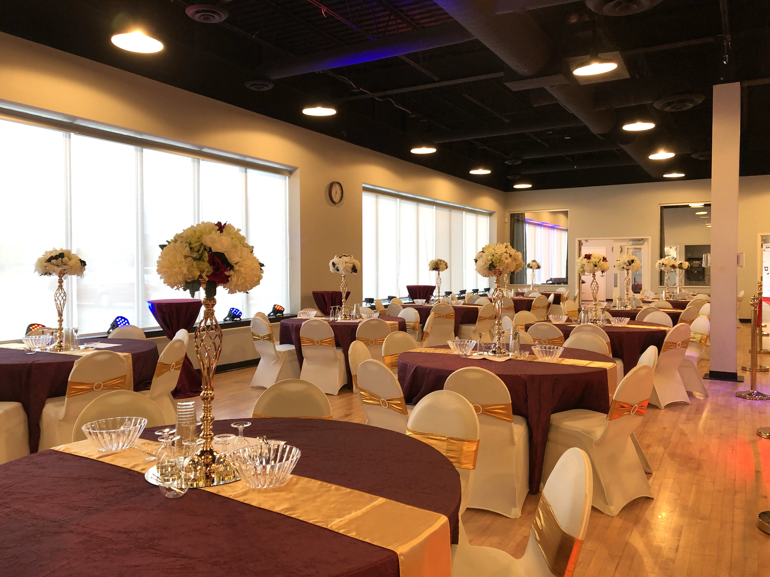 Midpointe Event Center Wedding Reception Burgundy and Gold Setup.jpg