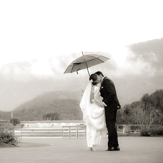 Embrace the rain! Holman Ranch | Carmel Valley, CA | wedding #sppblackandwhitephoto #holmanranch @holmanranch @staceypentlandphoto