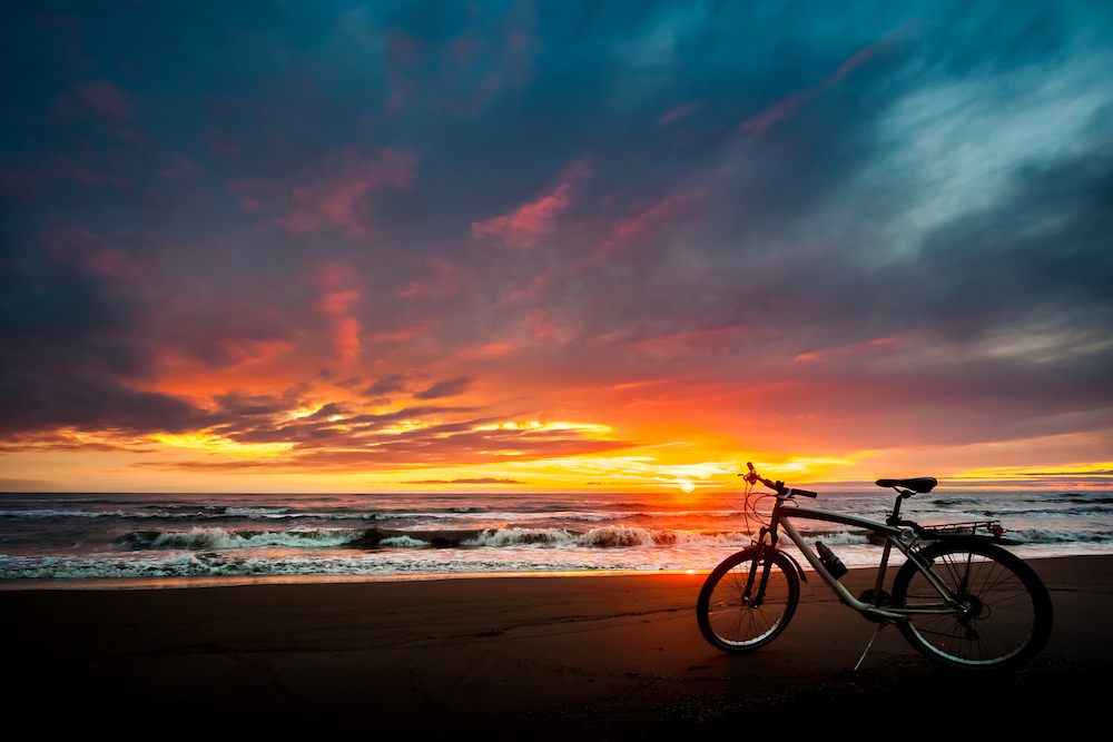 bigstock-Tourist-Bike-On-The-Coast-Of-T-176859382.jpg